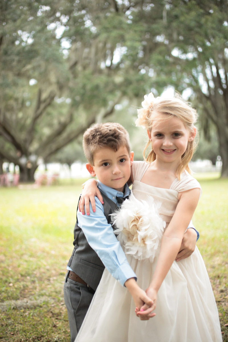 Flower girl in ivory dress and ring bearer in charoal vest and blue button up_