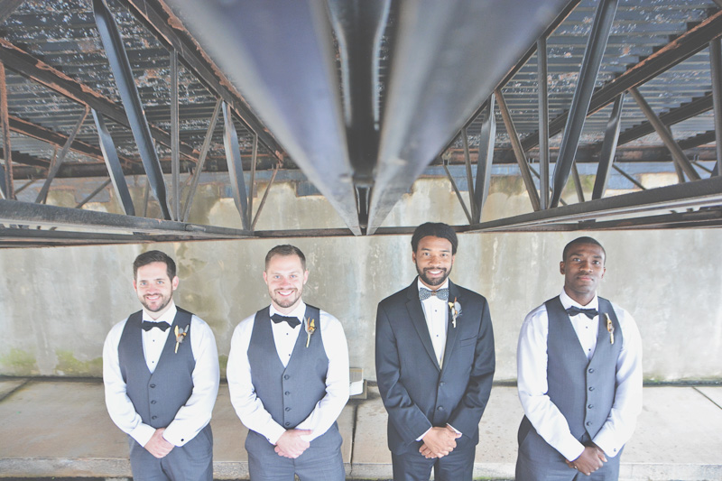 Groom and grooms men in charcoal gray vests
