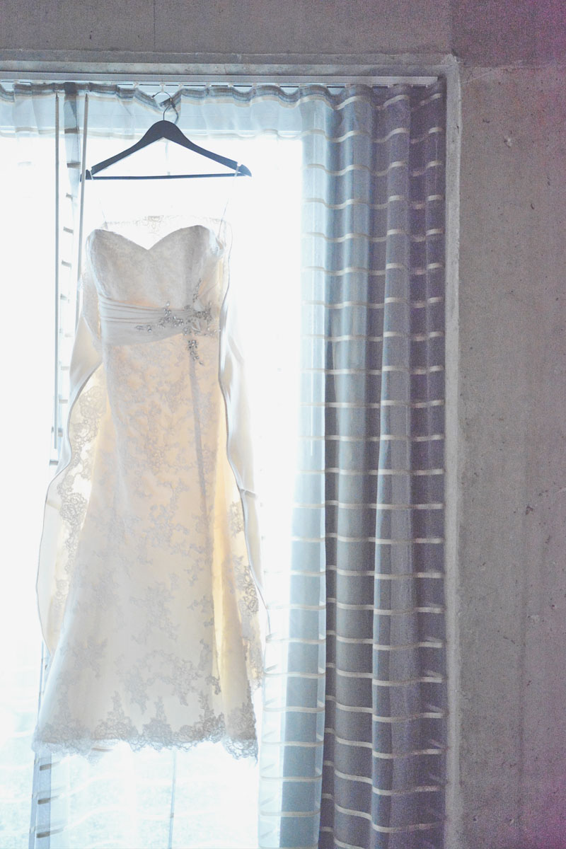 Lace A-line gown hanging in window