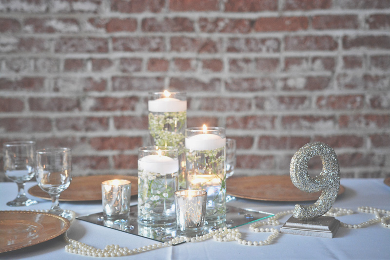 Personalized silver glitter table nuber and pearl theme concept_