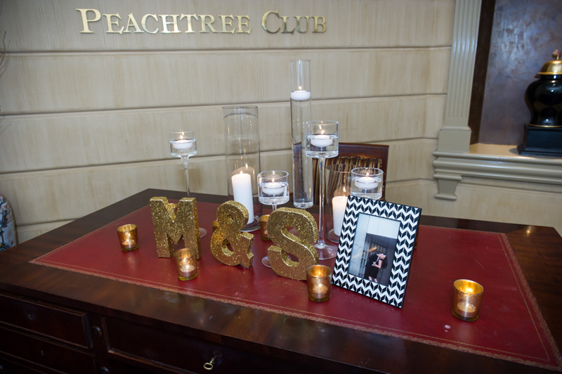 Personalized welcome table with gold glittered intials
