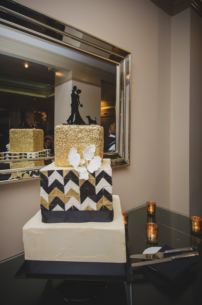Three tier gold glitter and black chevron cake