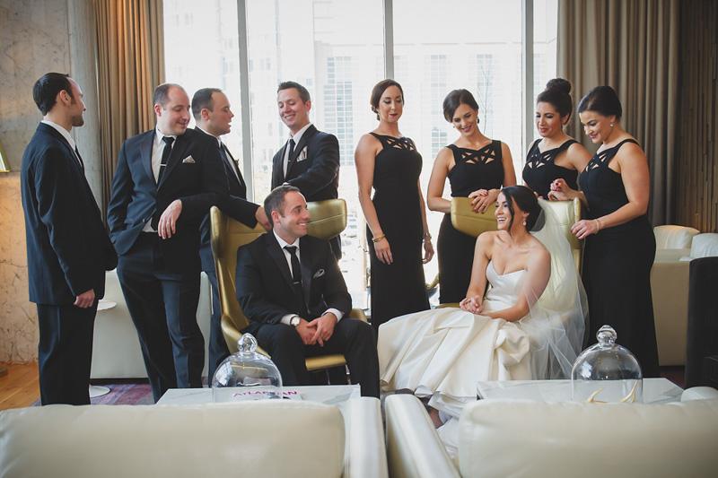 Wedding part in black floor lenth bridesmaids dress and groomsmen in black tuxes