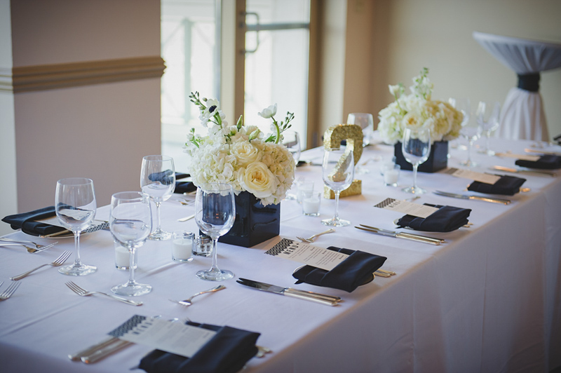 White hydrangea and stock centerpieces on white table runner