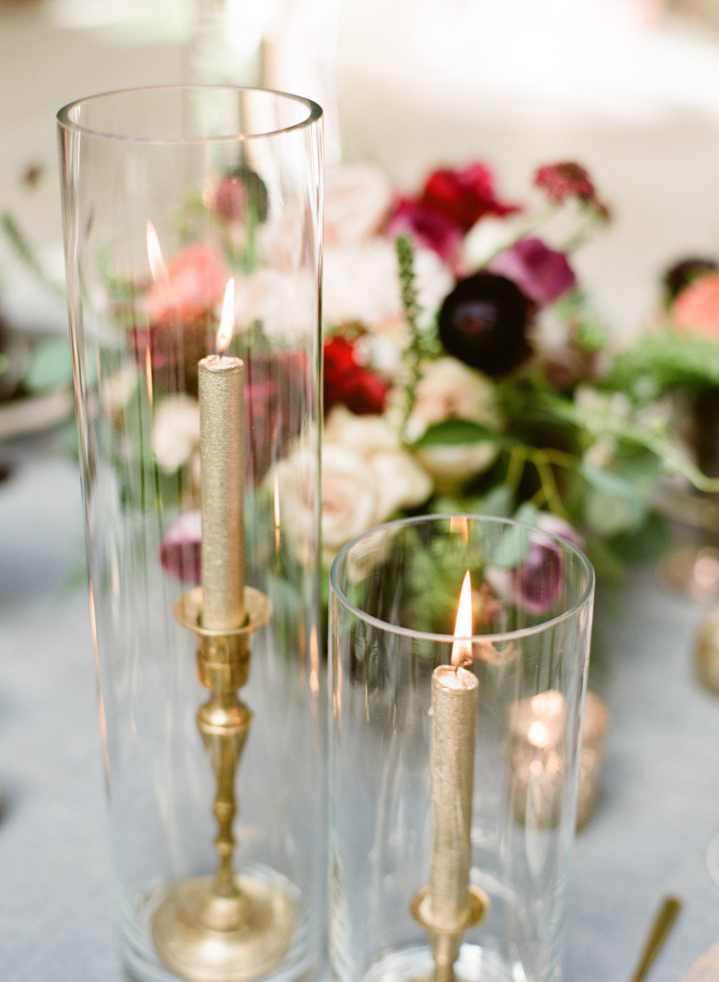 gold taped candles brass candlesticks in pillar vases