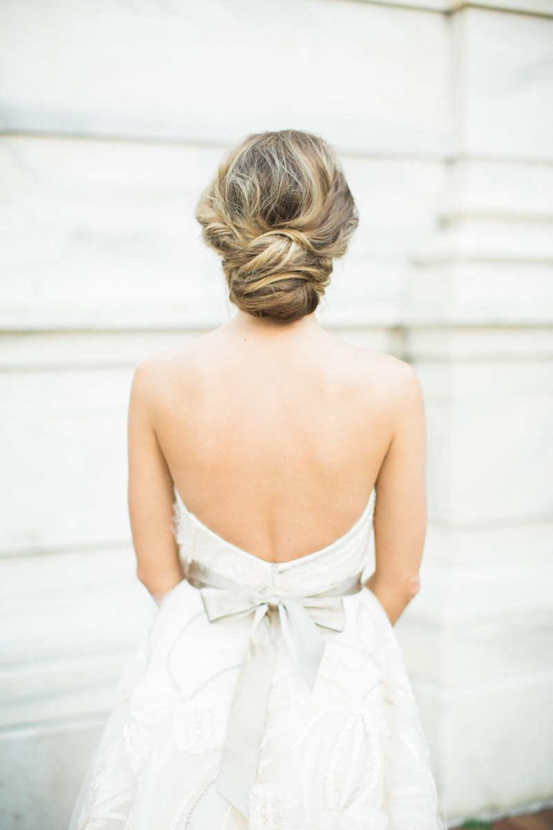 messy low updo wedding bride hairstyle - The Celebration Society