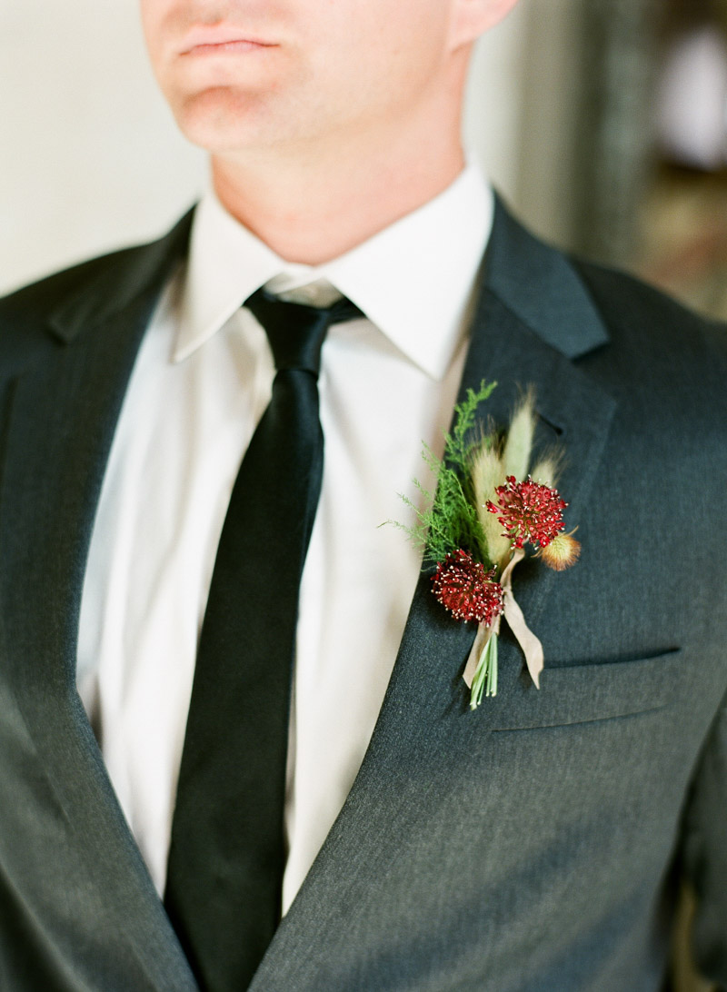 scabiosa boutonierre groom gray suit