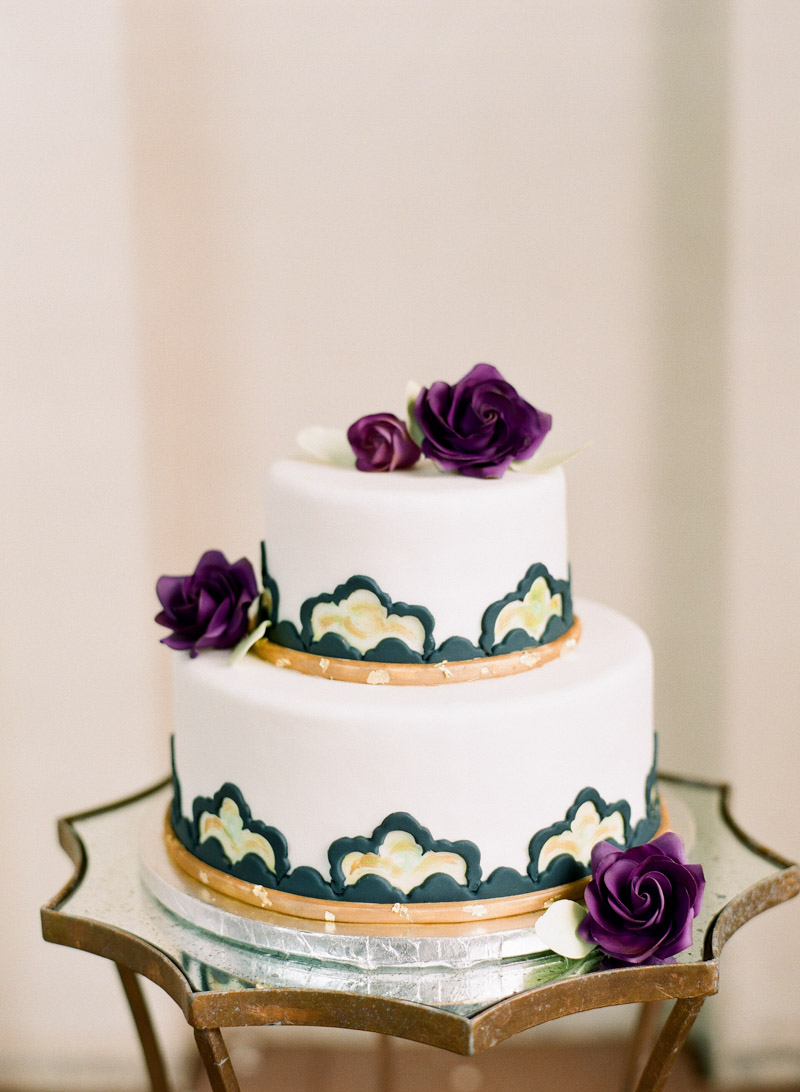 two tier vintage inspired wedding cake purple roses