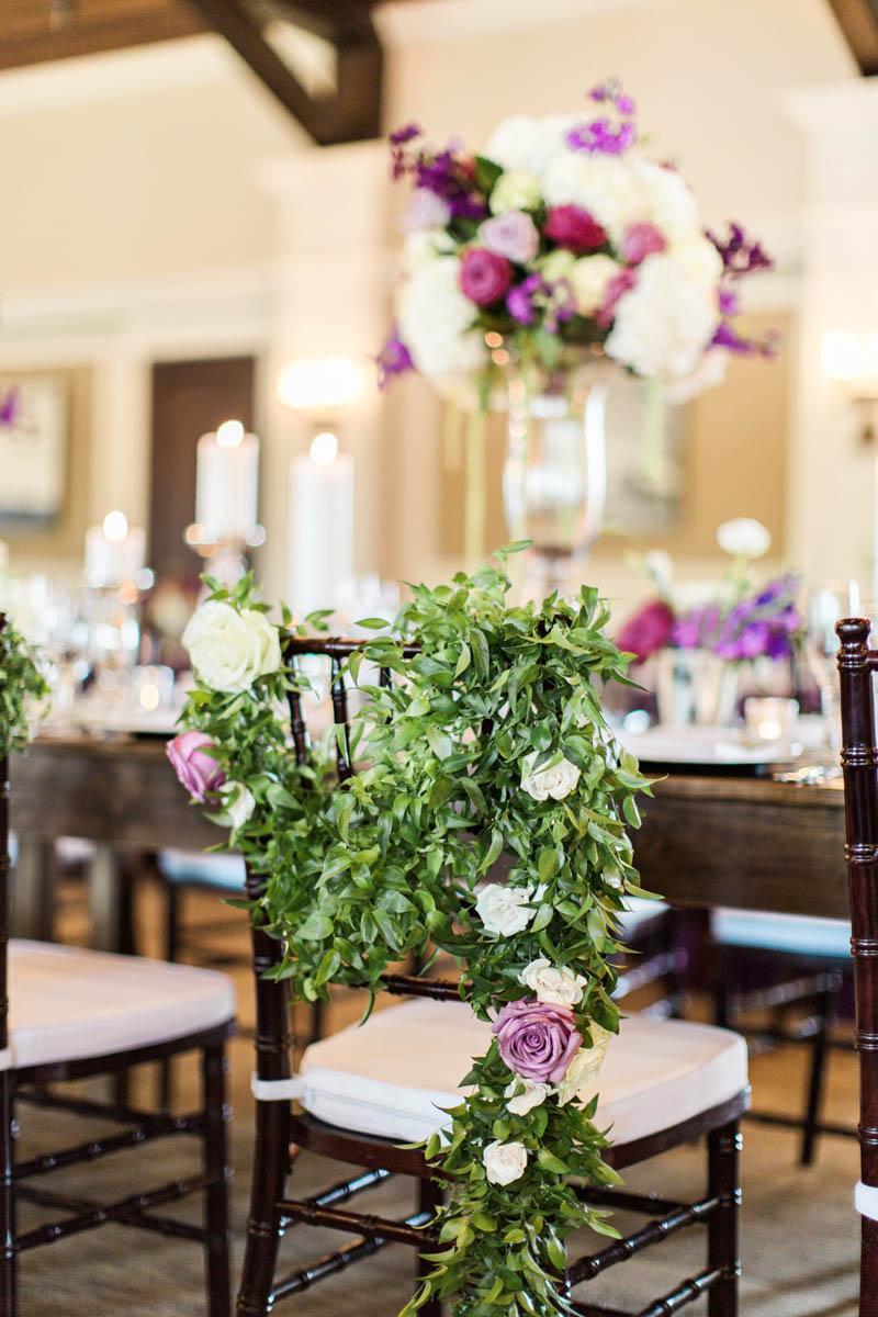 weddingreception-purplewhiterosechaircover