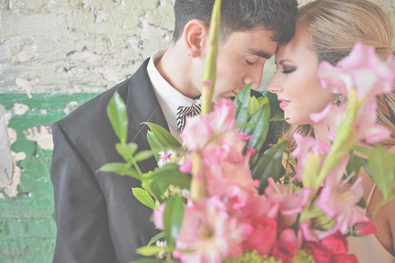 Bride & Groom Behind Flowers