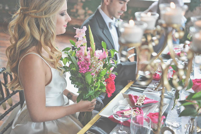 Bride Holding Flowers at Table