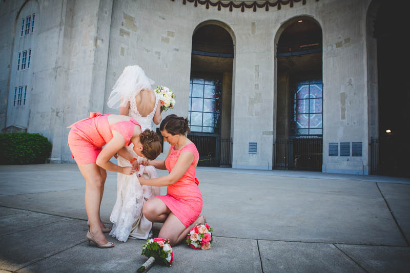 Bridesmaids Fixing Bride's Dress