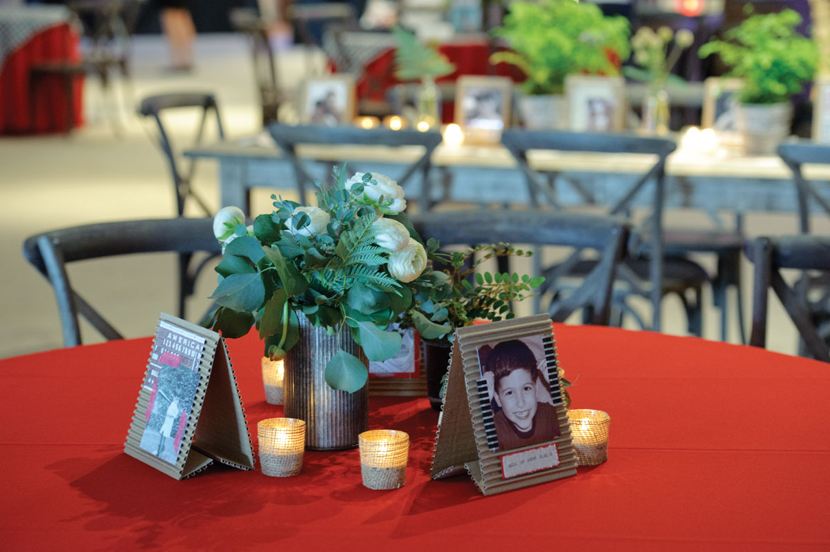 Centerpieces with Cardboard Pictures White Florals and Candles