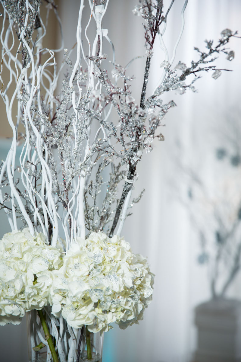 Frozen Themed White Floral Centerpiece With Branches Closeup