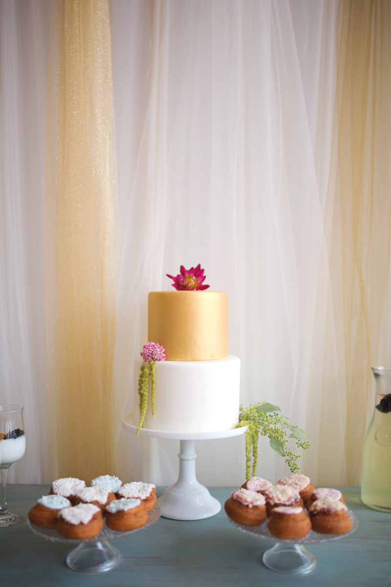 Gold and White Cake With Pink Floral Element