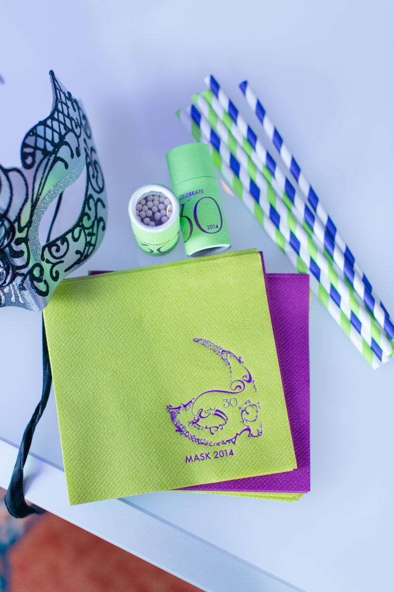 Green and Blue Straws and Green and Pink Napkins With Masquerade Mask Design