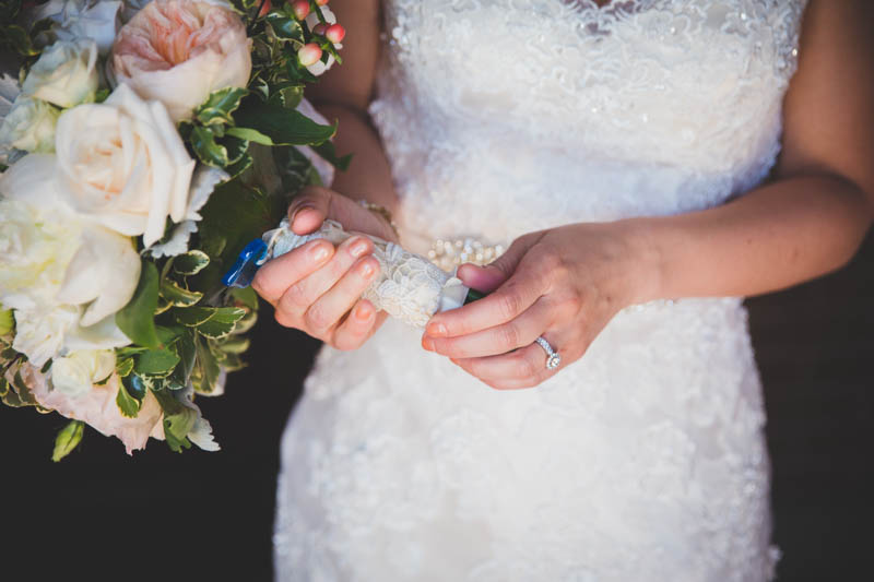 Holding Boquet & Wedding Ring