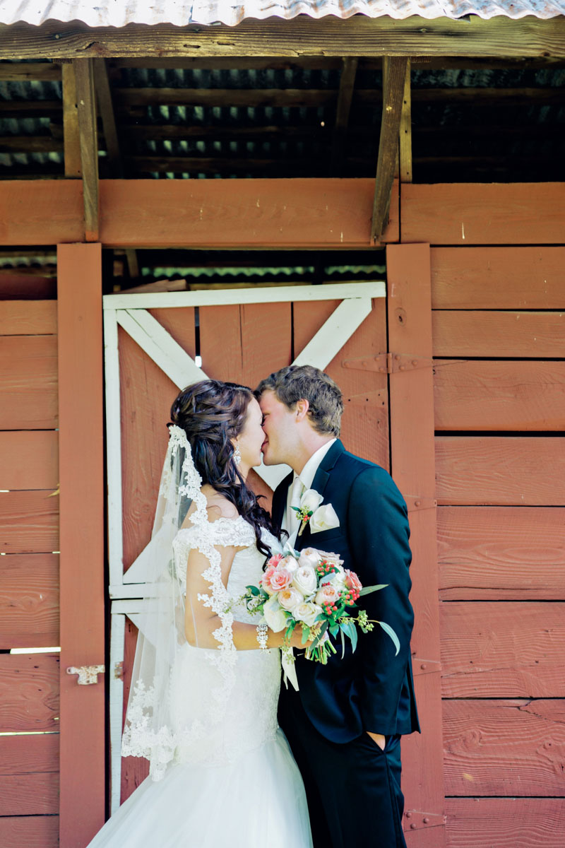 Kissing in Front of Barn_