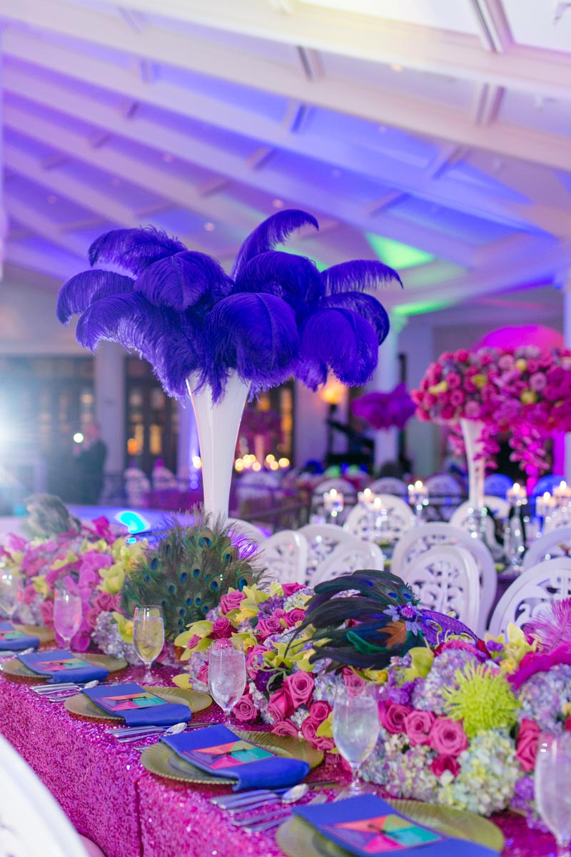 Masquerade Inspired Purple Feather Centerpiece With Pink Purple and Green Floral Centerpieces