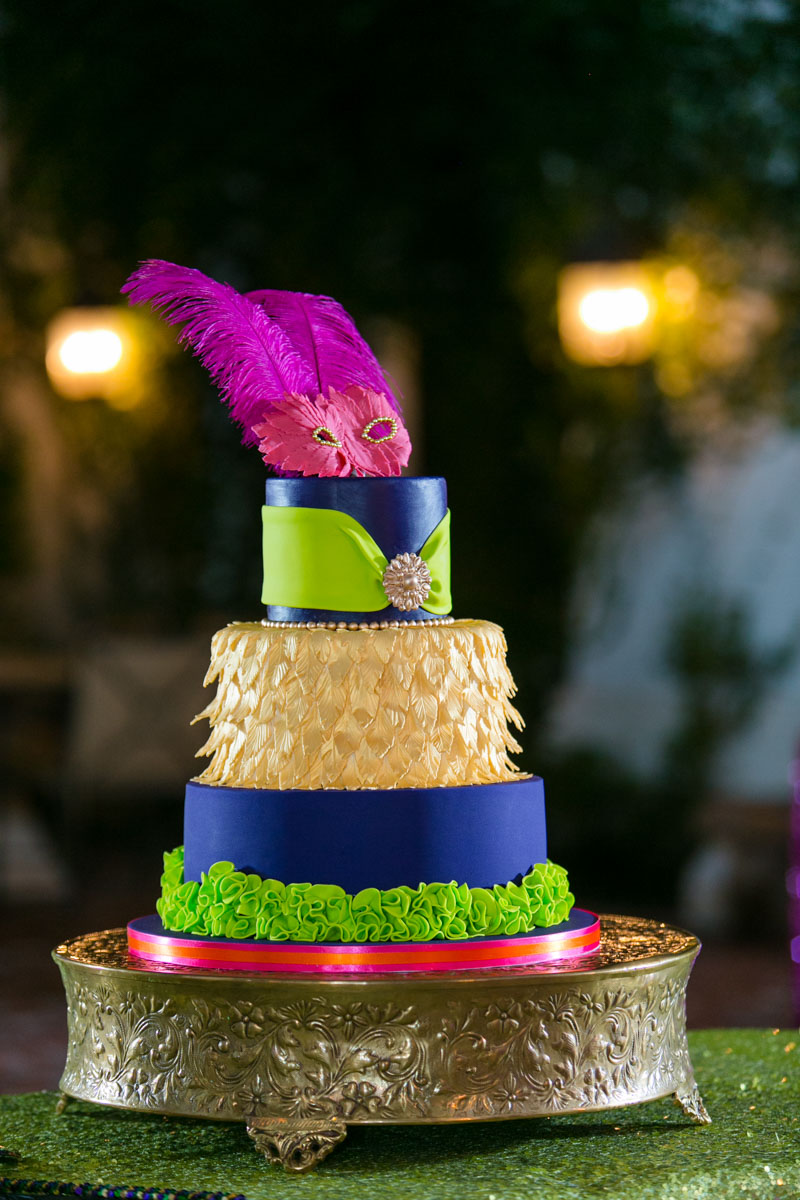Masquerade Themed Purple Gold Green and Pink Cake