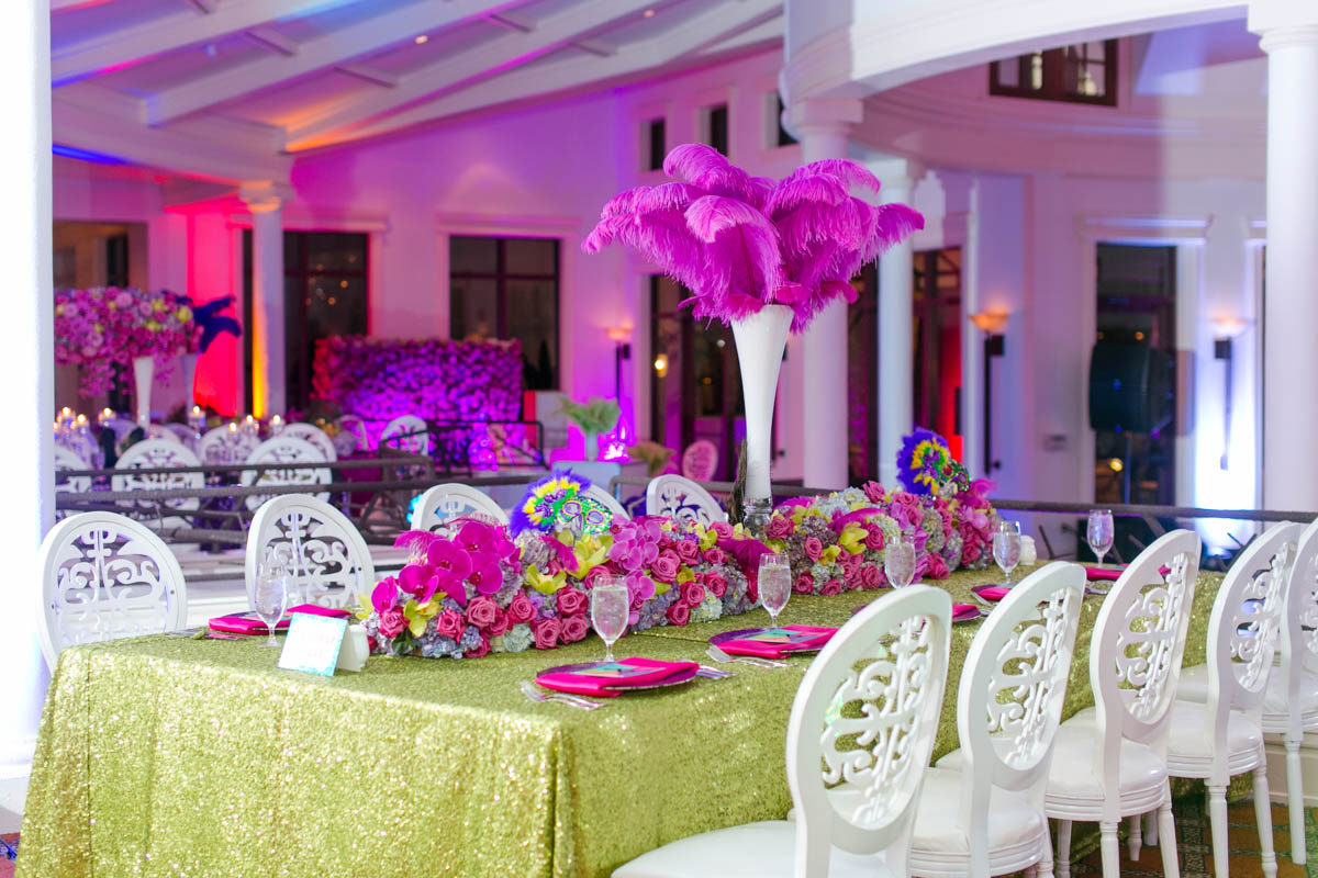 Masquerade Themed Table Decor With Pink Feather Centerpiece and Green Glitter Tableclothes