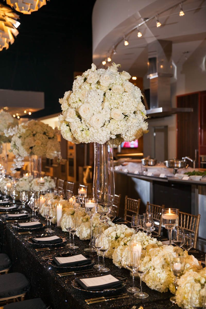 White Floral Centerpiece and Black Table Decor