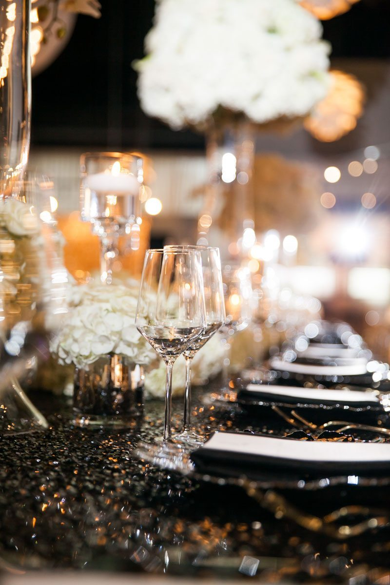Wineglasses and Black Plates on Black Glitter Tablecloth