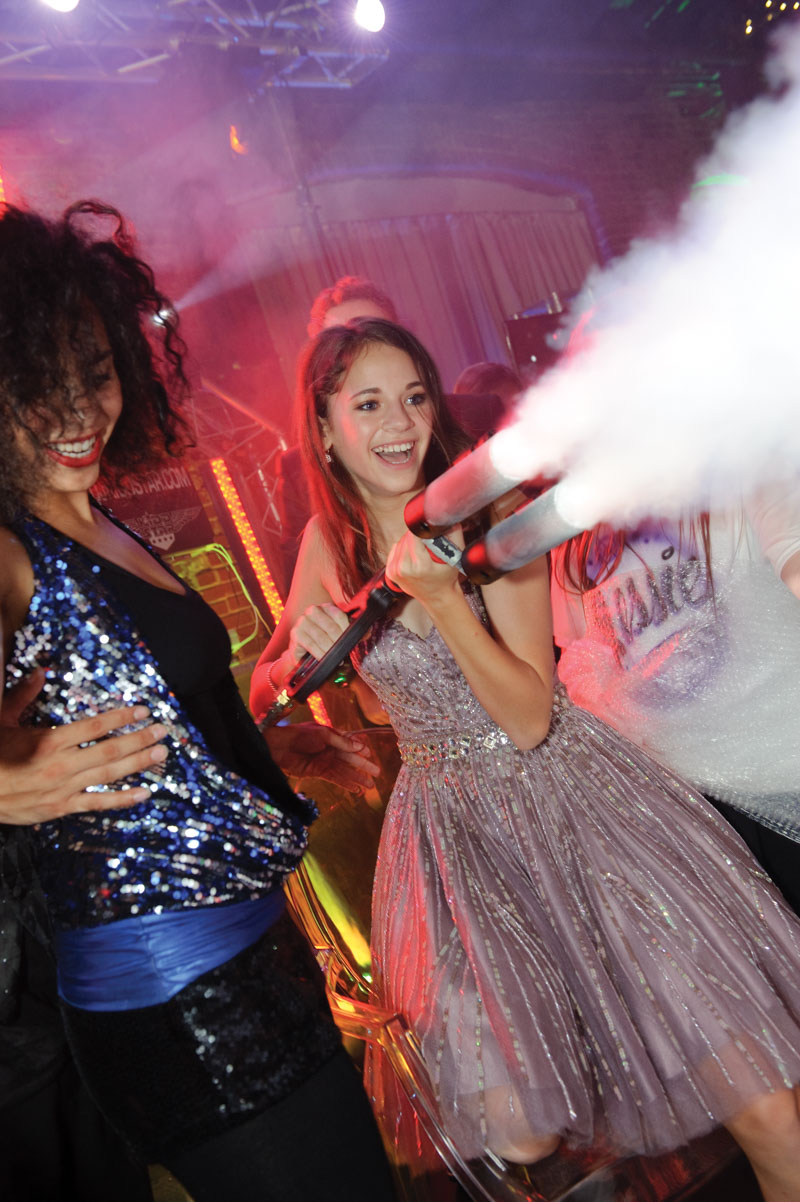 birthday girl spraying guests with paint powder