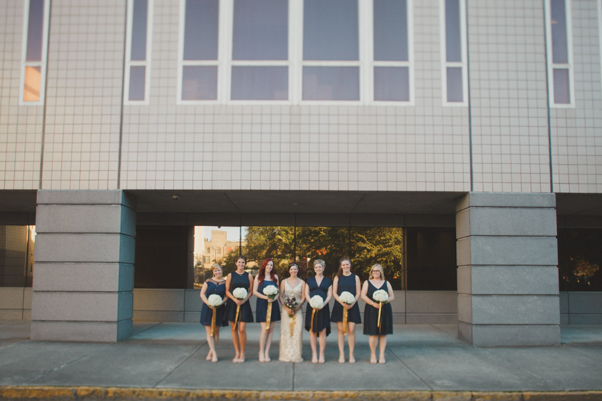 bride and her bridesmaids outside museum