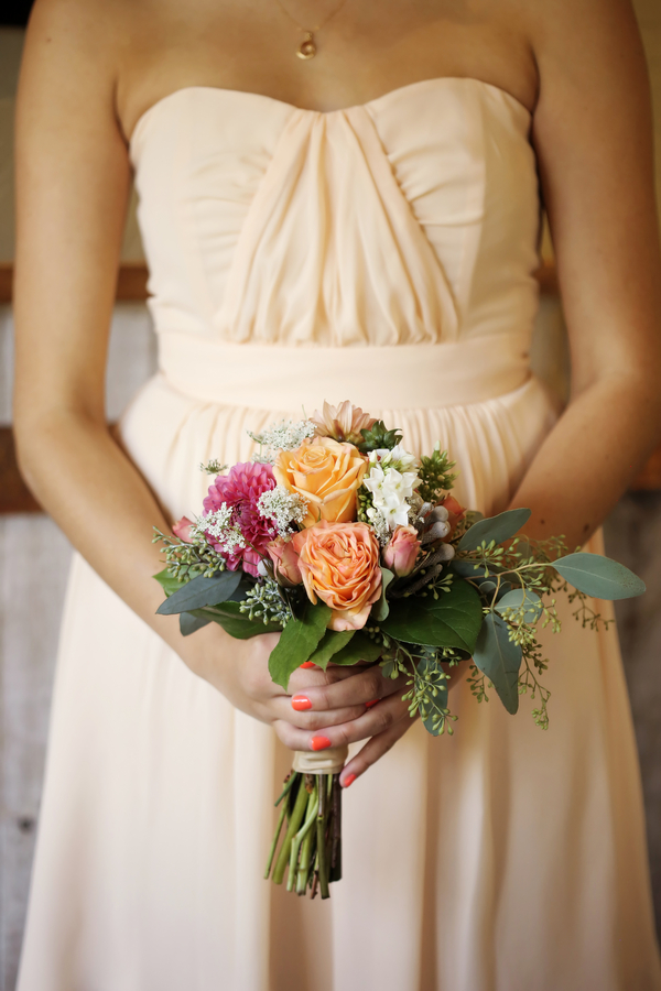 bridesmaid holding bouquet of roses