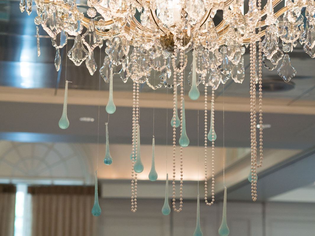 chandelier with strands of pearls and blue drops
