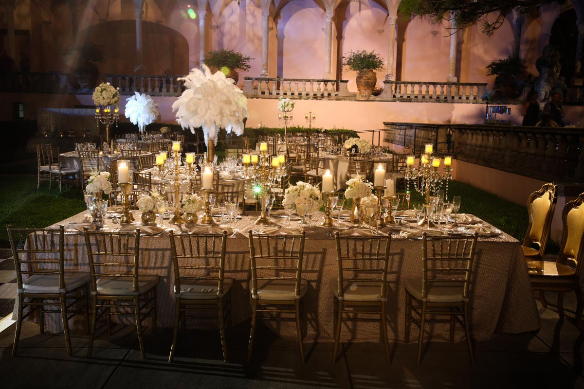 classy head table set up with chivari chairs at a birthday party