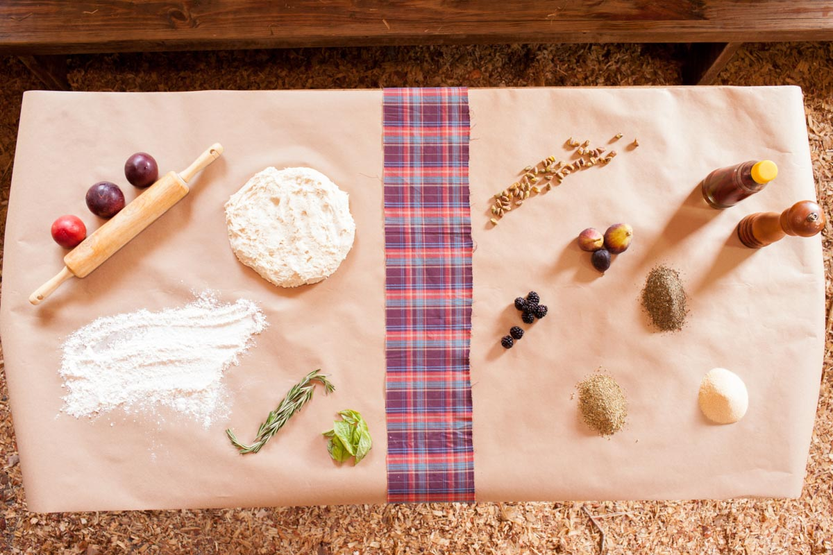 cooking ingredients laid out on table with plaid runner