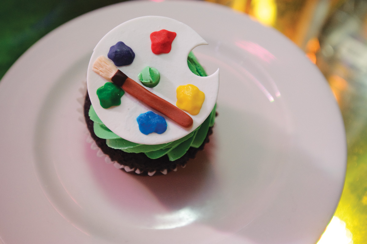 cupcake with paint pallet decoration on top