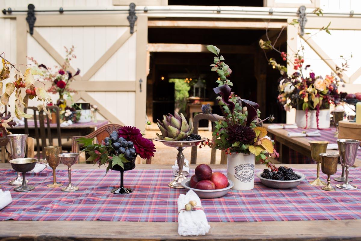 farm table setting with floral arrangements
