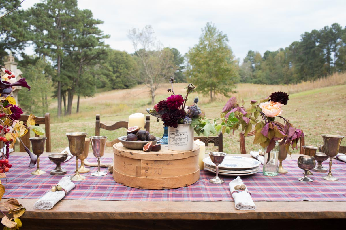 farm table setting with flowers and goblets