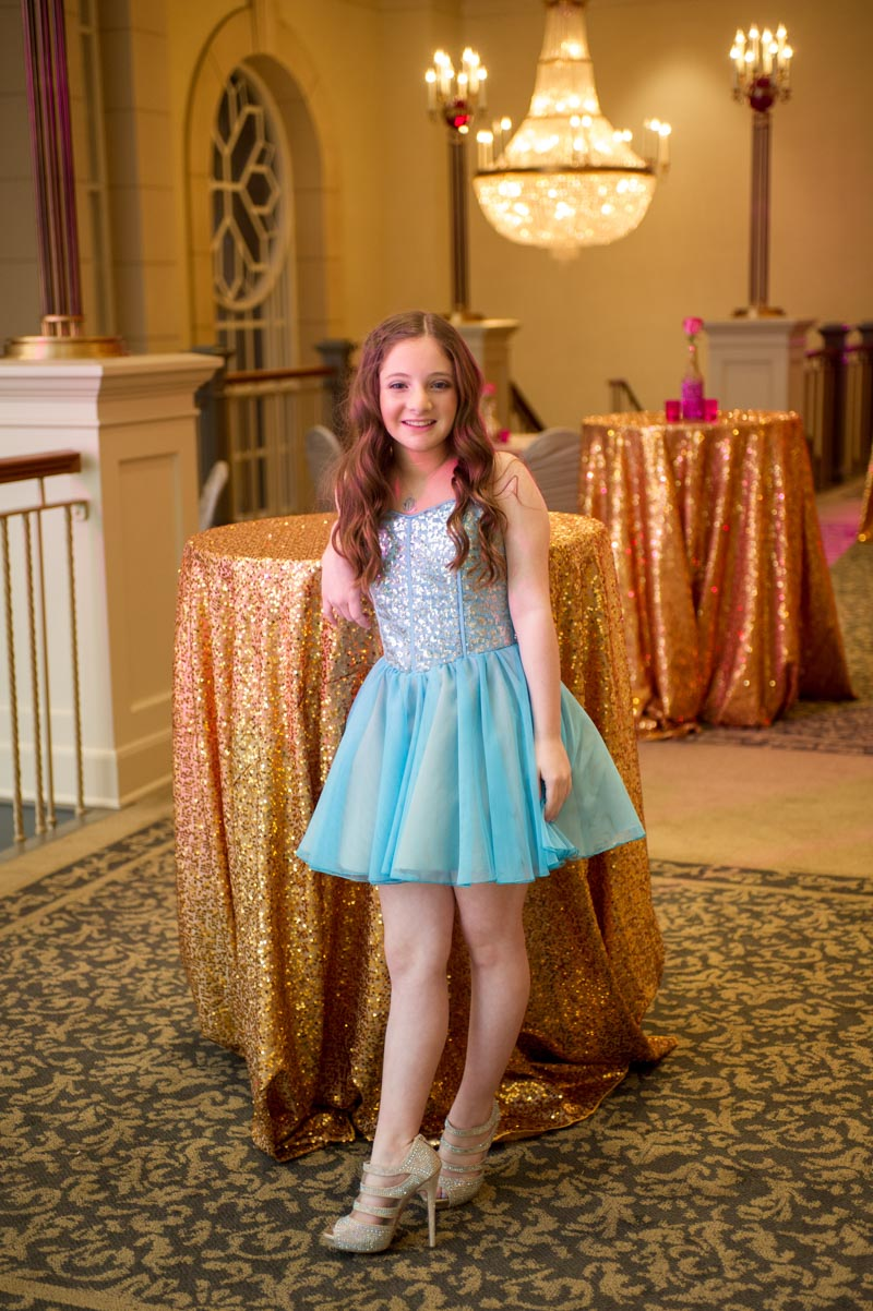 girl at her mitzvah in blue sparkly dress and heels