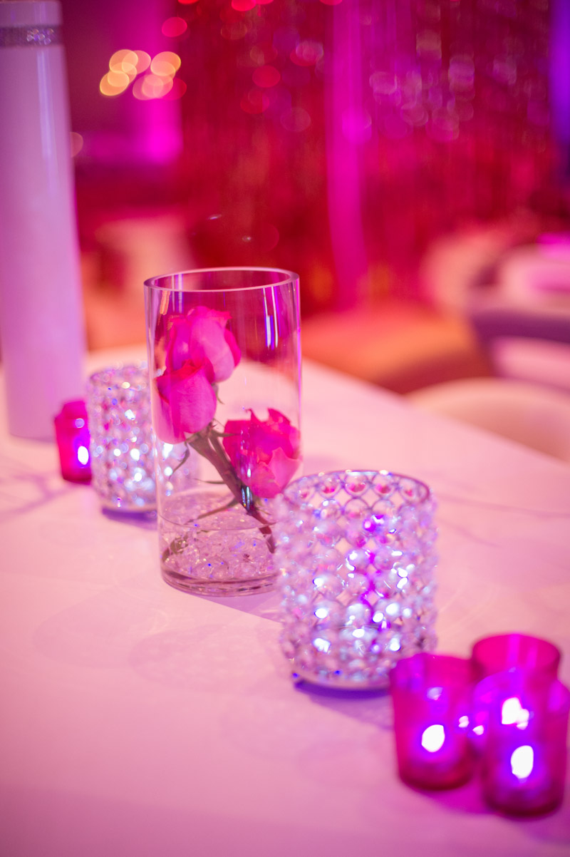 glass centerpieces with small pink roses