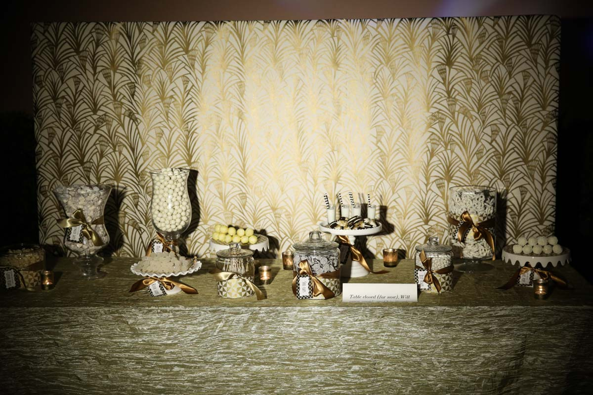 gold and white themed dessert table