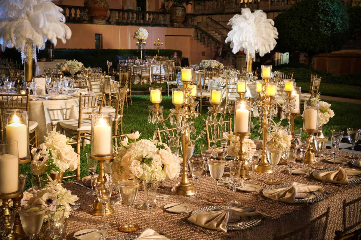 gold and white themed table settings for a party