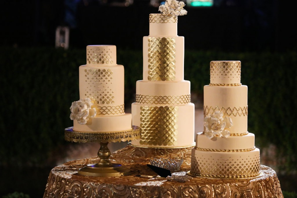 gold and white tiered cakes