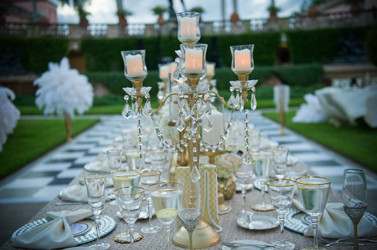 gold center piece with candles and jewels