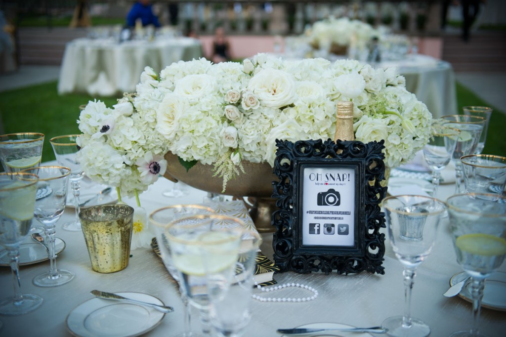 large bouquet of white hydrangeas and roses in center of table