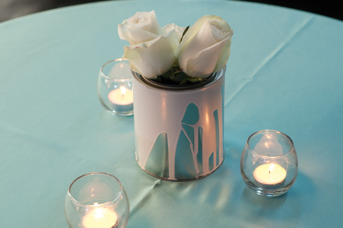 light blue paint can and roses center piece