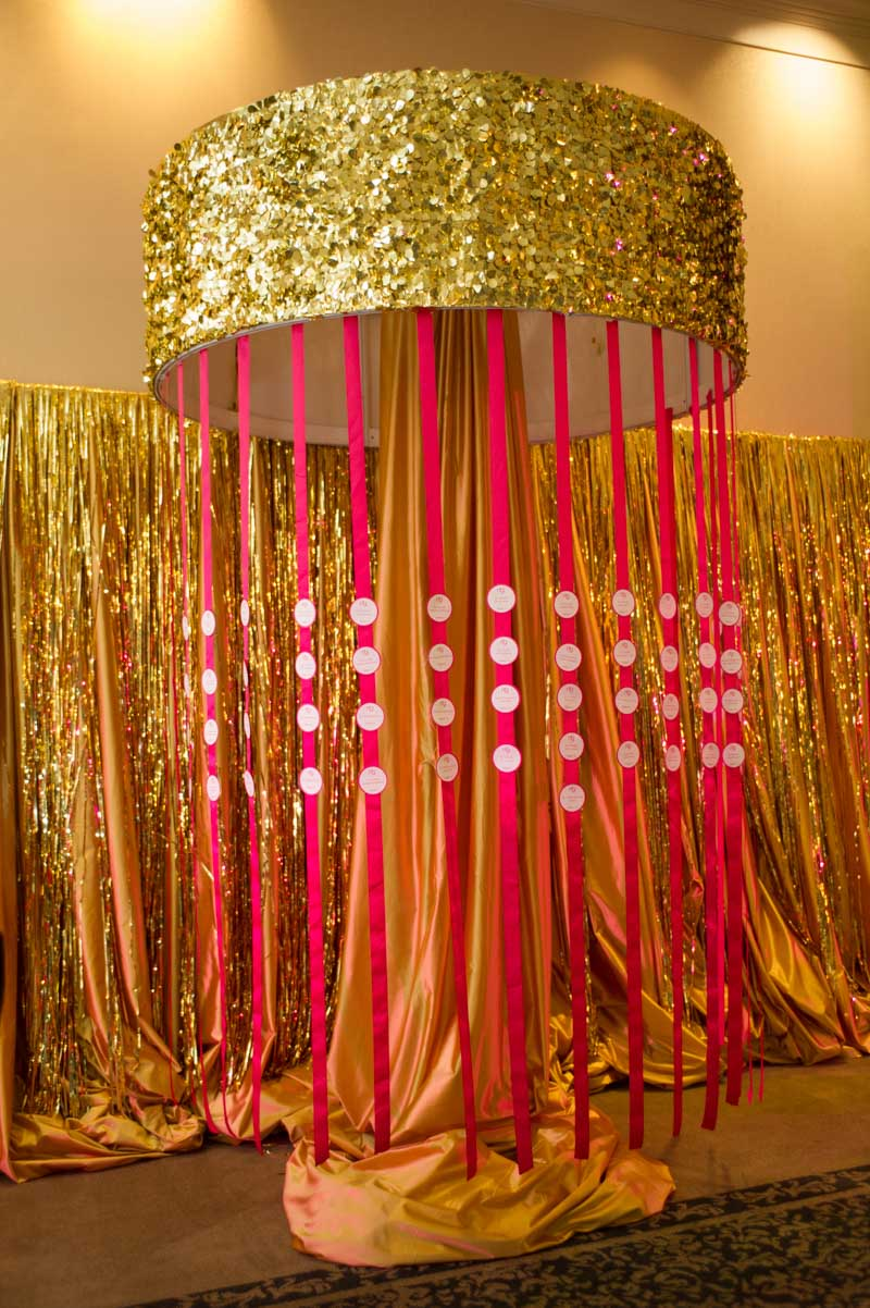 pink and gold glittered table numbers