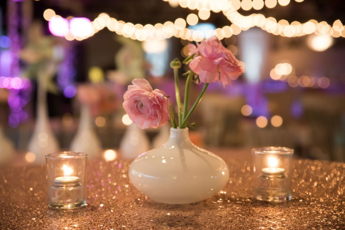 pink rose centerpiece on top of glittered table cloth