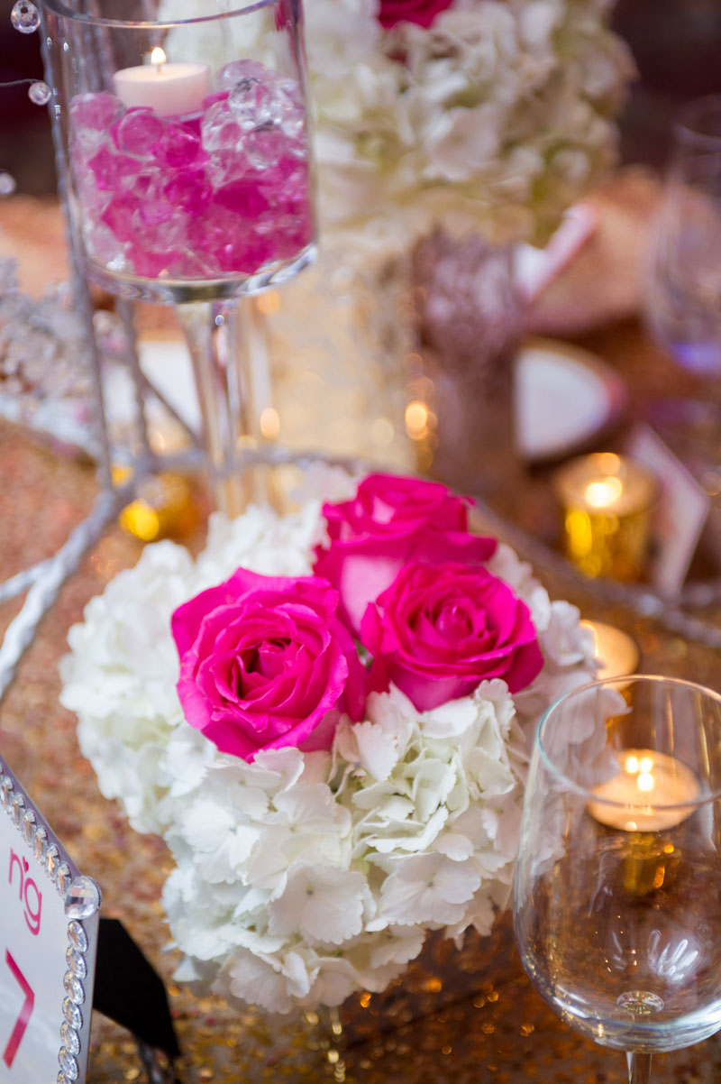 pink roses in white hydrangeas center piece