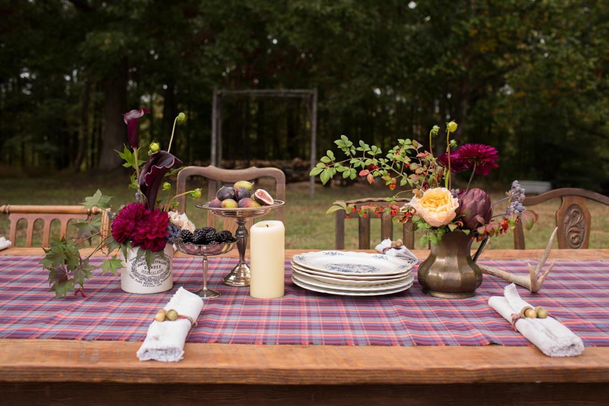 rustic centerpieces with roses, greens and blackberries