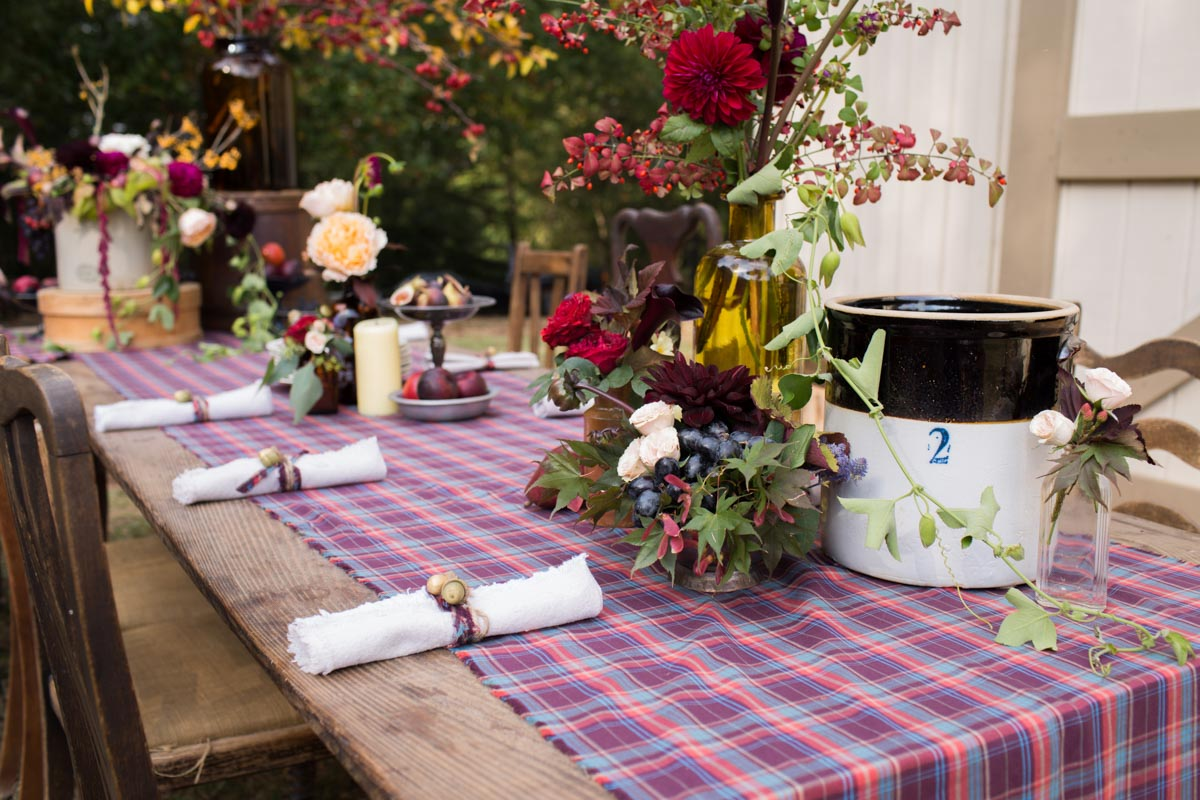 rustic table setting with plaid table runner