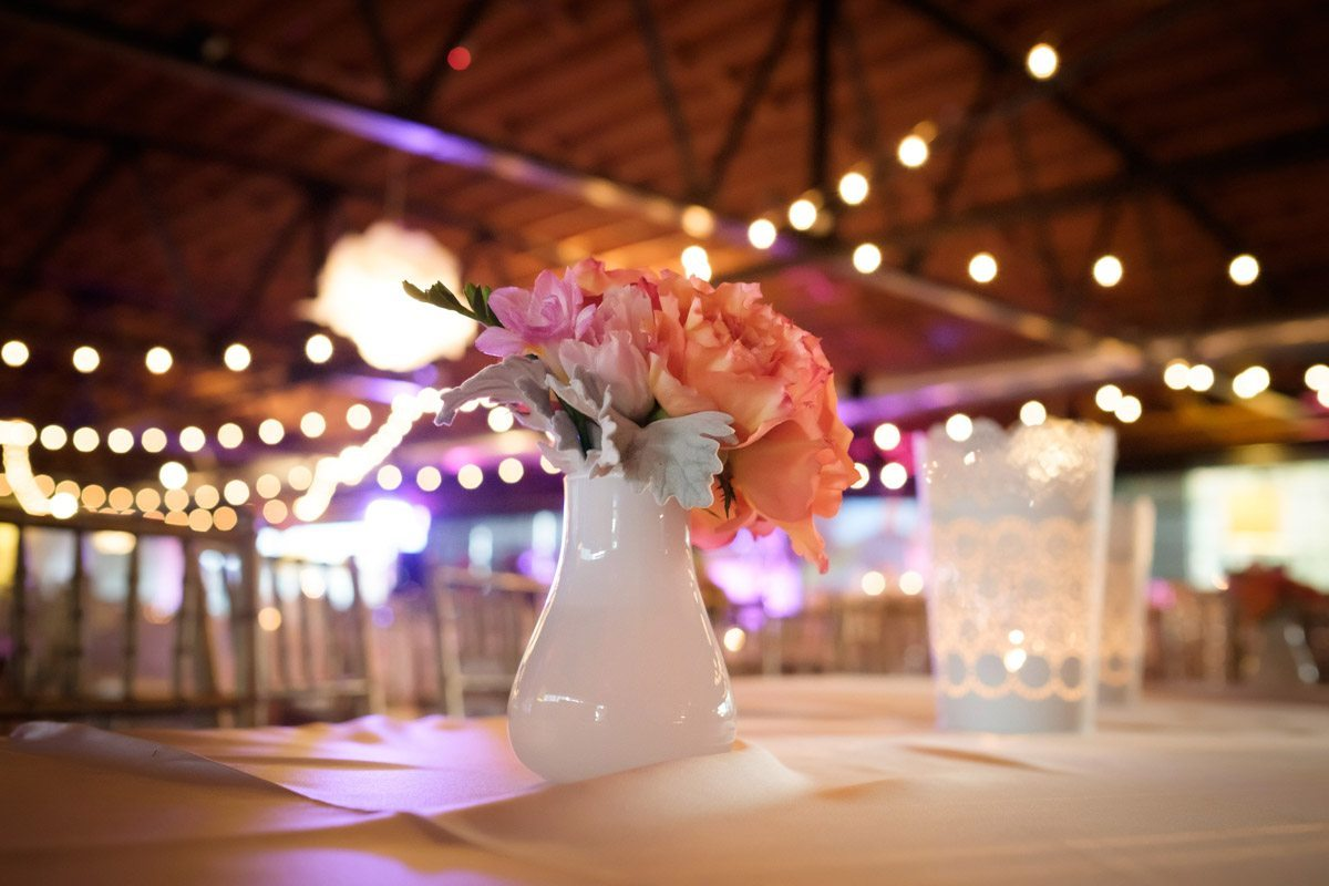 small pink and orange floral centerpiece